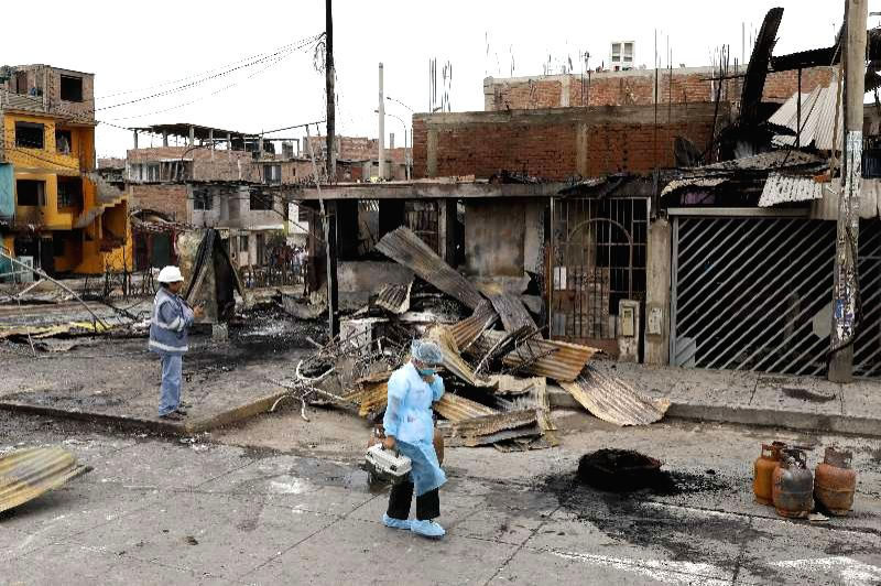 People work at the site of a gas tanker explosion in Lima, Peru, on Jan. 23, 2020. The number of deaths from a gas tanker explosion in Lima on Thursday has risen to ...