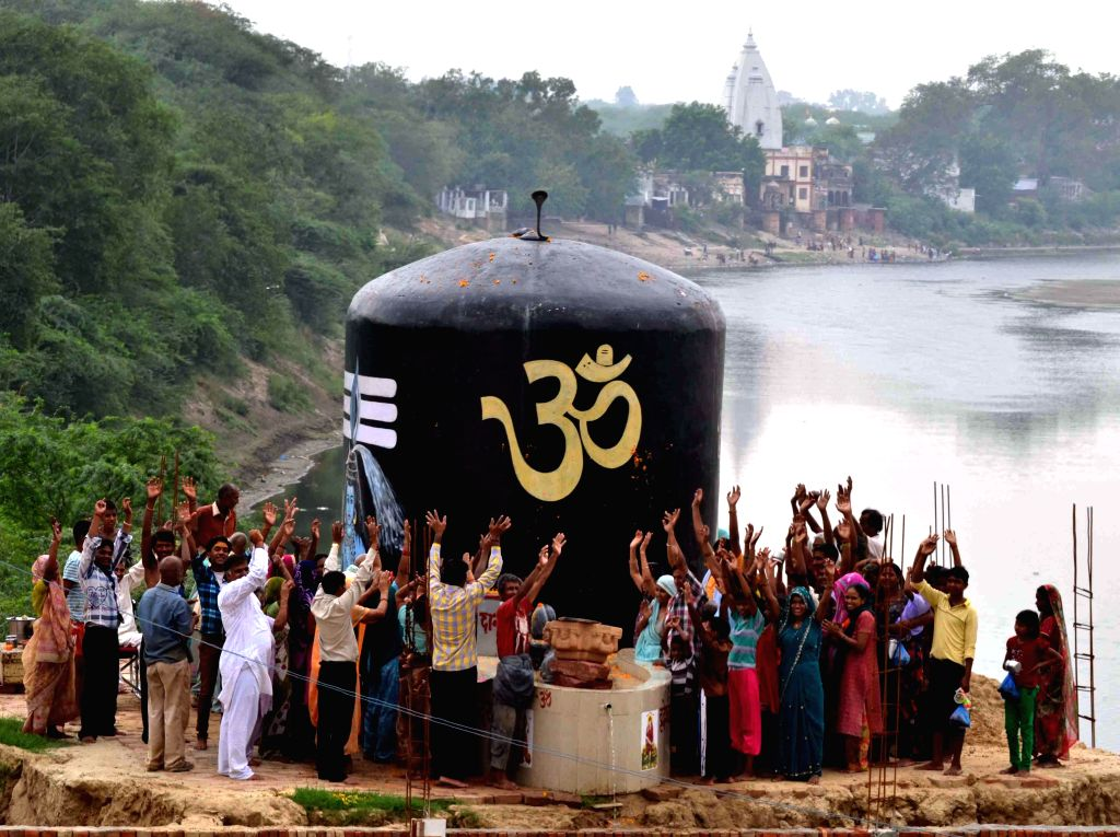 People worship a `Shivling` in Agra during the holy month of Sawan on July 21, 2014.