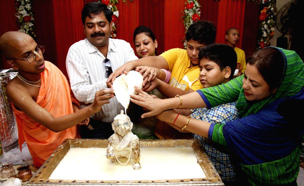 People worship lord Krishna on Janmashtami at ISKCON Temple in New Delhi on Aug 18, 2014.