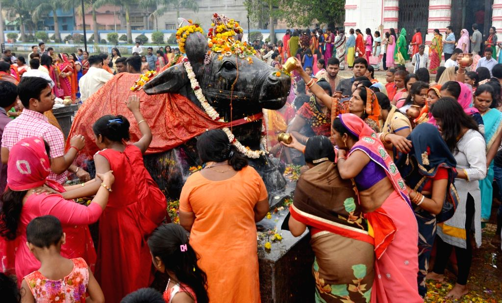 People worship lord Shiva on Maha Shivratri at Bhukailash Shiv Mandir in Kolkata, on March 4, 2019.
