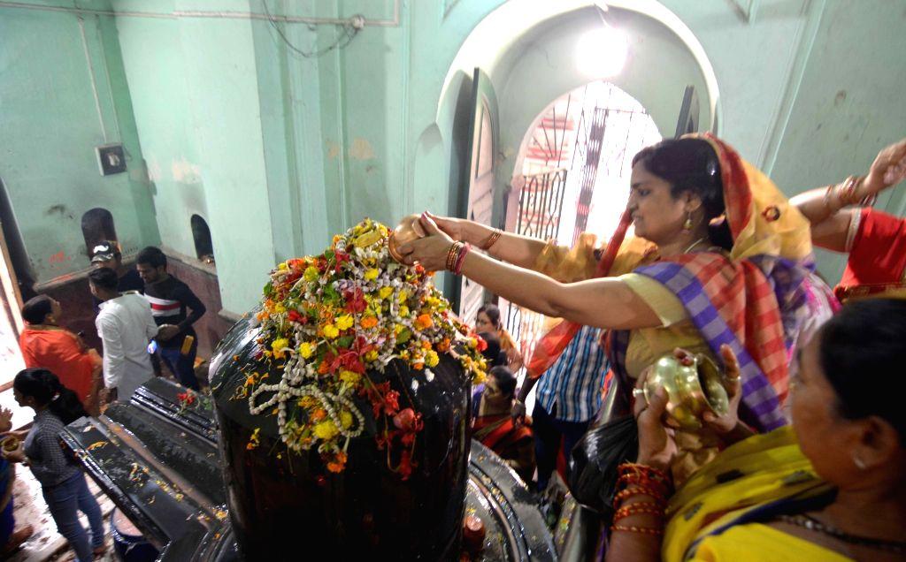 People worship lord Shiva on Maha Shivratri at Bhukailash Shiv Mandir in Kolkata, on March 4, 2019.
