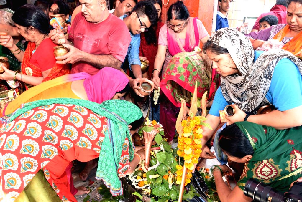 People worship Lord Shiva on the last Monday of the holy month of 'Shrawan' in Patna on Aug 12, 2019.