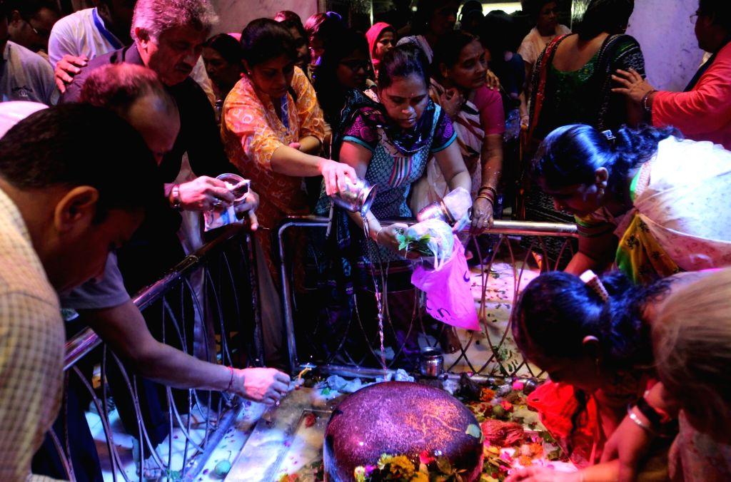 People worship lord Shiva on the third Monday of Sawan -holy moth of Hindu calendar in Mumbai on Aug 8, 2016.