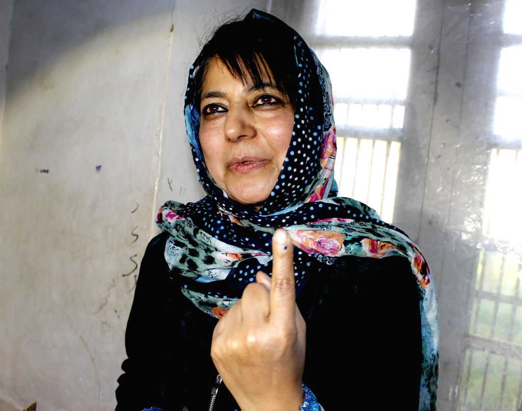 Peoples Democratic Party (PDP) chief Mehbooba Mufti Sayeed shows her fore finger marked with phosphorous ink after casting her vote at a polling booth during the sixth phase of 2014 Lok Sabha Polls ..
