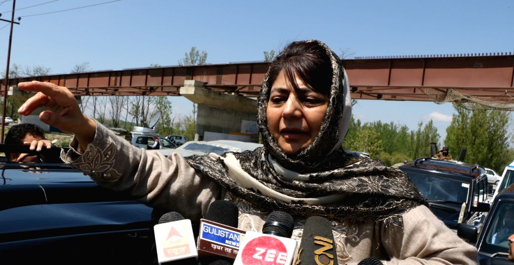Peoples Democratic Party (PDP) President Mehbooba Mufti talks to media persons in Srinagar, on April 10, 2019. - Mehbooba Mufti