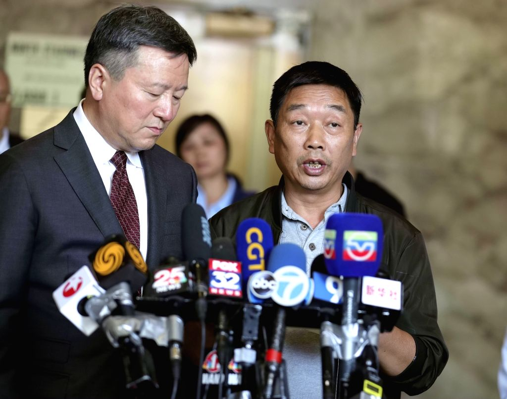 PEORIA, July 19, 2019 - Zhang Yingying's father (R) speaks at a press conference after sentencing in Peoria, Illinois, the United States, July 18, 2019. Brendt Christensen, the kidnapper and killer ...