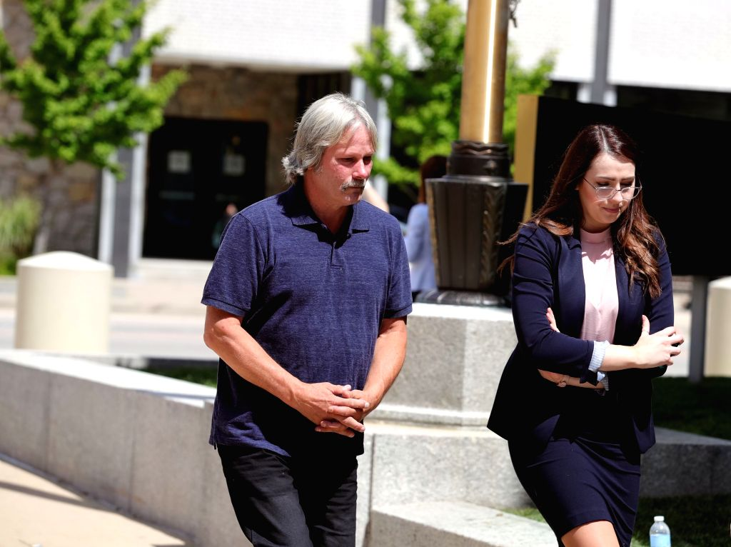 PEORIA (U.S.), July 17, 2019 Brendt Christensen's father Michael Christensen (L) heads to the federal courthouse building in Peoria, Illinois, the United States, on July 17, 2019. After a ...