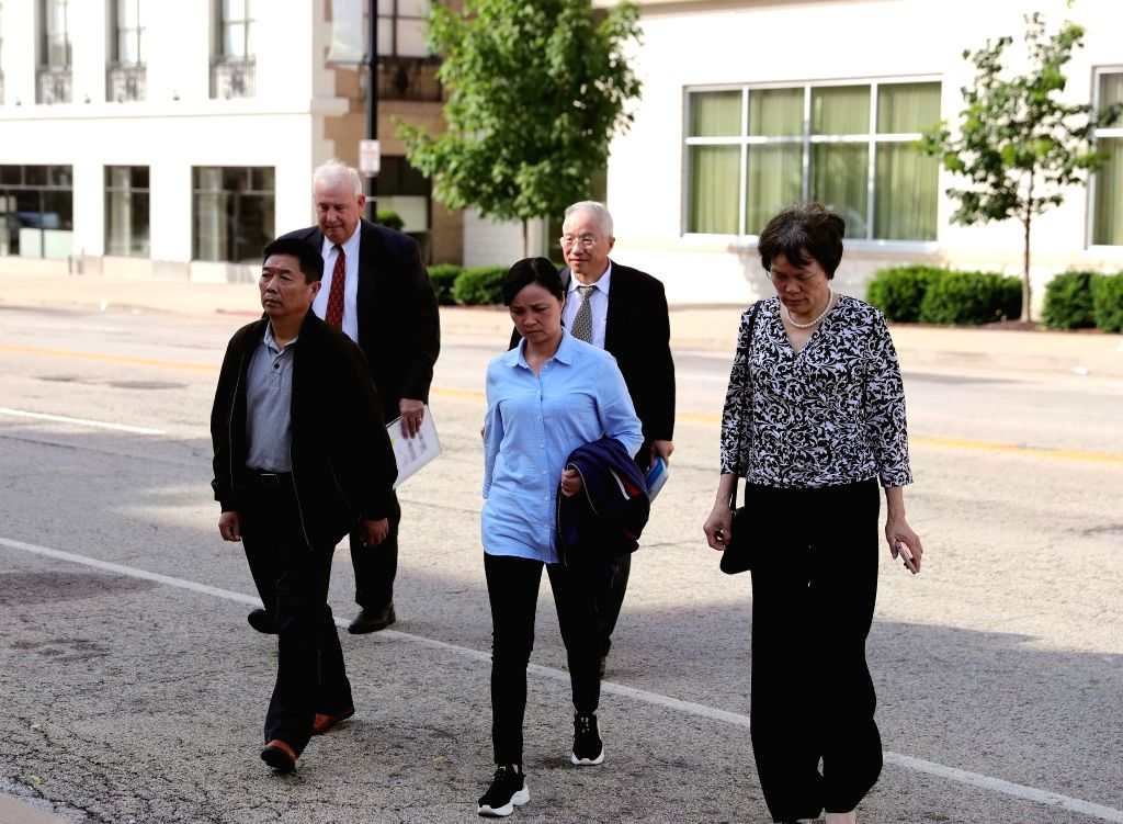 PEORIA (U.S.), July 18, 2019 Family members of Chinese scholar Zhang Yingying head to a federal courthouse building in Peoria, Illinois, the United States, on July 18, 2019. Brendt ...