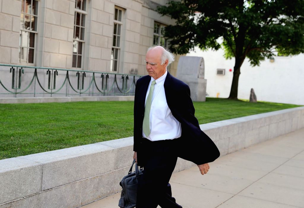 PEORIA (U.S.), July 18, 2019 Robert Tucker, defense attorney for Brendt Christensen, heads to a federal courthouse building in Peoria, Illinois, the United States, on July 18, 2019. ...