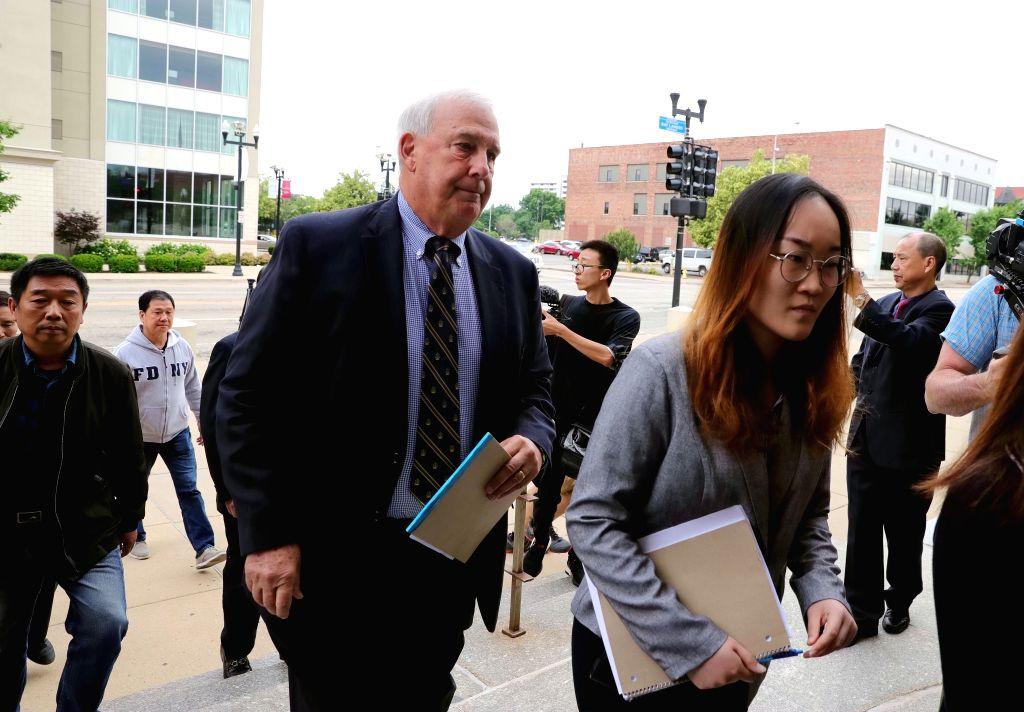 PEORIA (U.S.), June 12, 2019 Steve Beckett (2nd R, front), a lawyer working with the family of visiting Chinese scholar Zhang Yingying, heads to the federal courthouse building in Peoria, ...