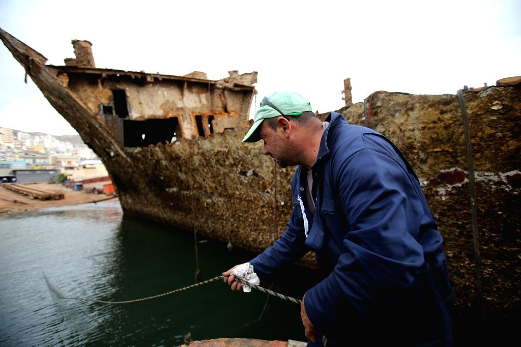 "PERAMA, Oct. 31, 2018 - A worker clears debris from the shipwreck of ""Corfu Island"" in the repair zone of Perama, Greece, on Oct. 30, 2018. Thirty two years after she sunk at Dock II of ..."