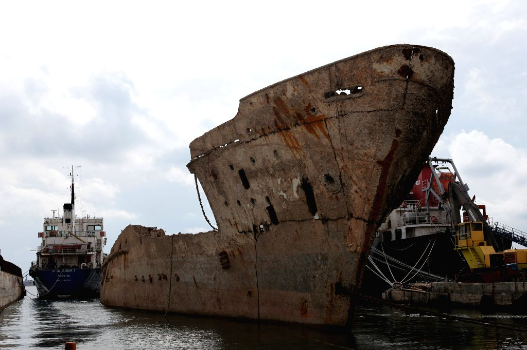 "PERAMA, Oct. 31, 2018 - The shipwreck of ""Corfu Island"" is seen next to other vessels in the repair zone of Perama, Greece, on Oct. 30, 2018. Thirty two years after she sunk at Dock II of ..."
