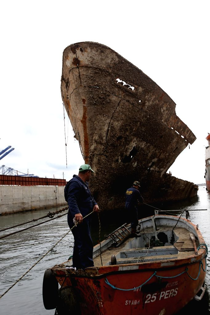 "PERAMA, Oct. 31, 2018 - Workers clear debris from the shipwreck of ""Corfu Island"" in the repair zone of Perama, Greece, on Oct. 30, 2018. Thirty two years after she sunk at Dock II of ..."