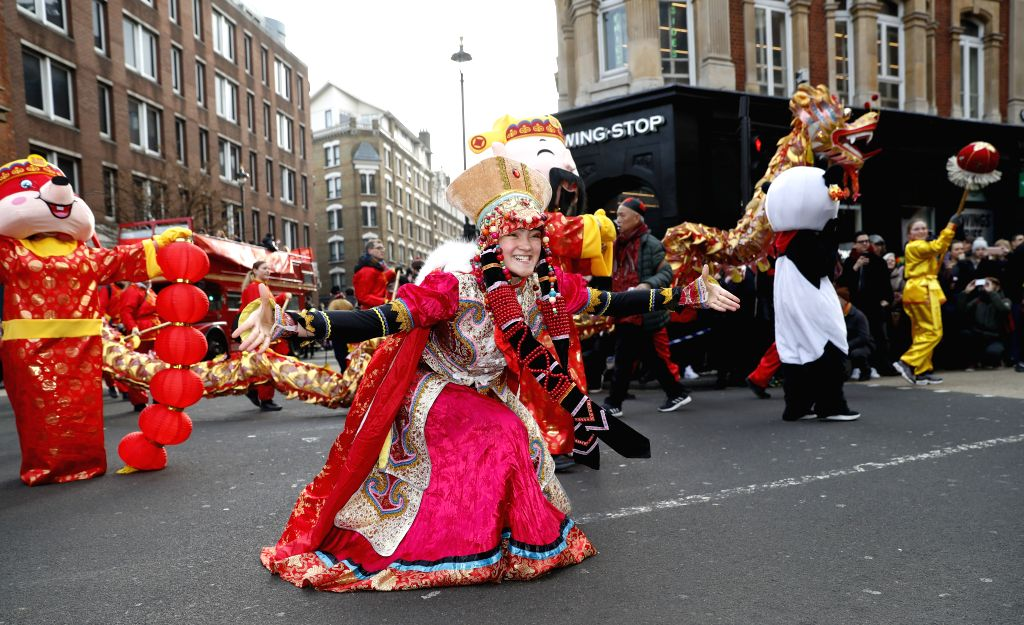 Performers take part in a Chinese Lunar New Year parade in London, Britain, on Jan. 26, 2020.