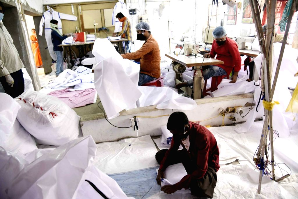Personal Protective Equiment (PPE) suits being prepared for Railway workers at a unit in Patna's Pataliputra during the extended nationwide lockdown imposed to mitigate the spread of ...
