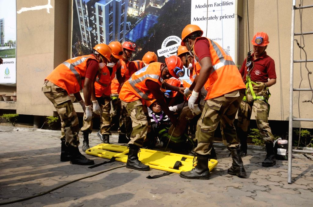 Personnel of Kolkata Police's Disaster Management Group (DMG) conduct mock drills in Kolkata, on Nov 19, 2015.