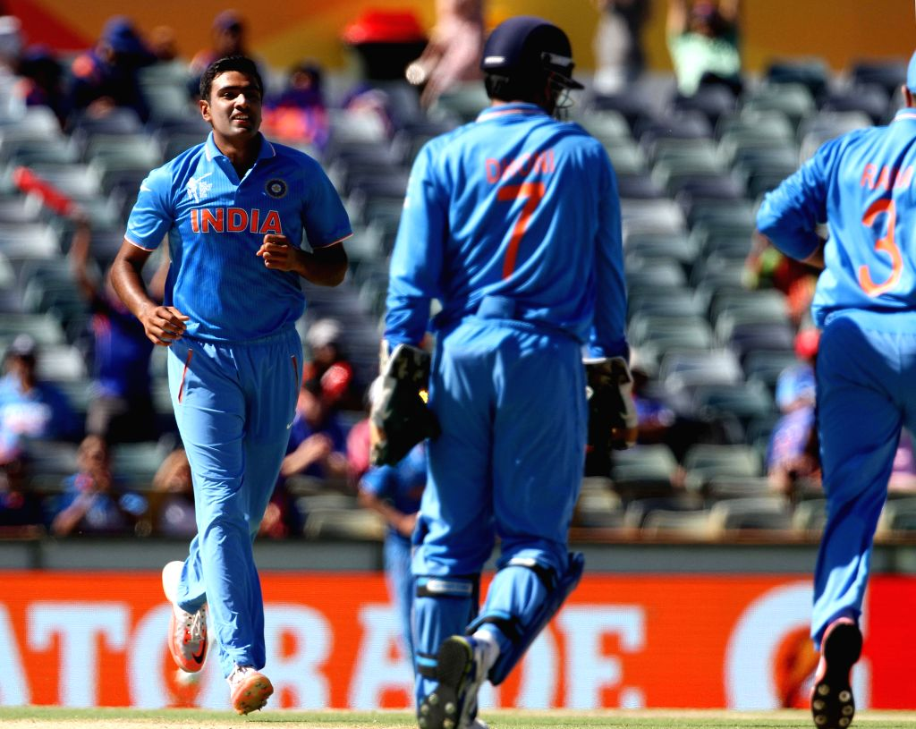 Indian players celebrate fall of a wicket during during an ICC World Cup 2015 match between India and UAE at Western Australia Cricket Association Ground, Perth, Australia on Feb 28, 2015.