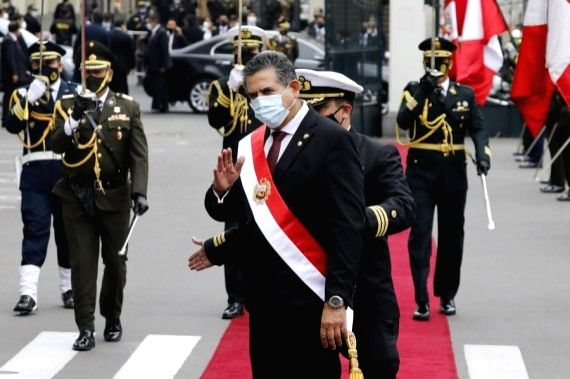 Peruvian President Manuel Merino (front) greets supporters after his swearing-in ceremony as the country's president, at the National Congress, in Lima, Peru, on Nov. 10, 2020.