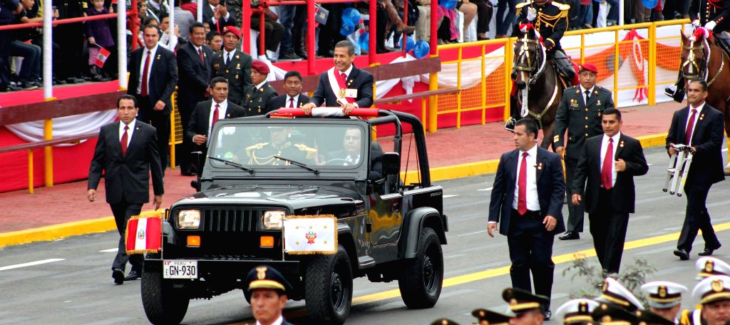 Peruvian President Ollanta Humala (C) takes part at the Civic-Military Parade to commemorate the 194th anniversary of Peru's Independence, in Lima city, capital of ...