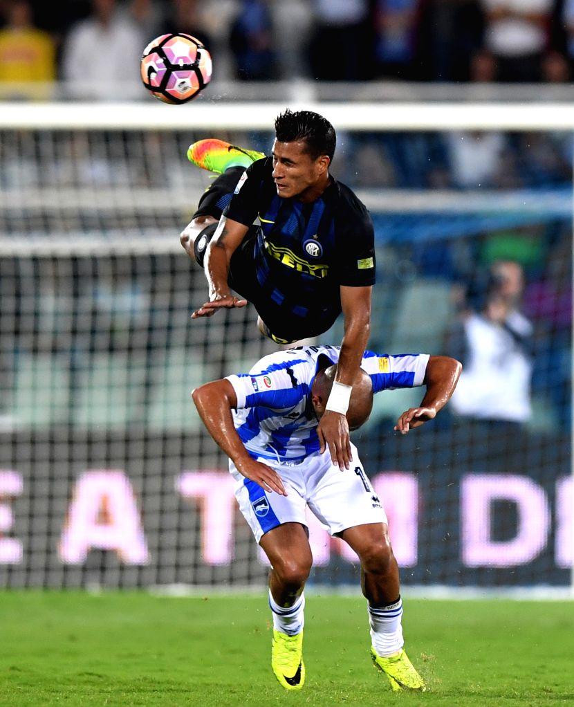 PESCARA, Sept. 12, 2016 - Jeison Murillo(up) of Inter Milan vies with Ahmad Benali of Pescara during their Italian Serie A football match in Pescara, Italy, Sept. 11, 2016. Inter Milan won 2-1.