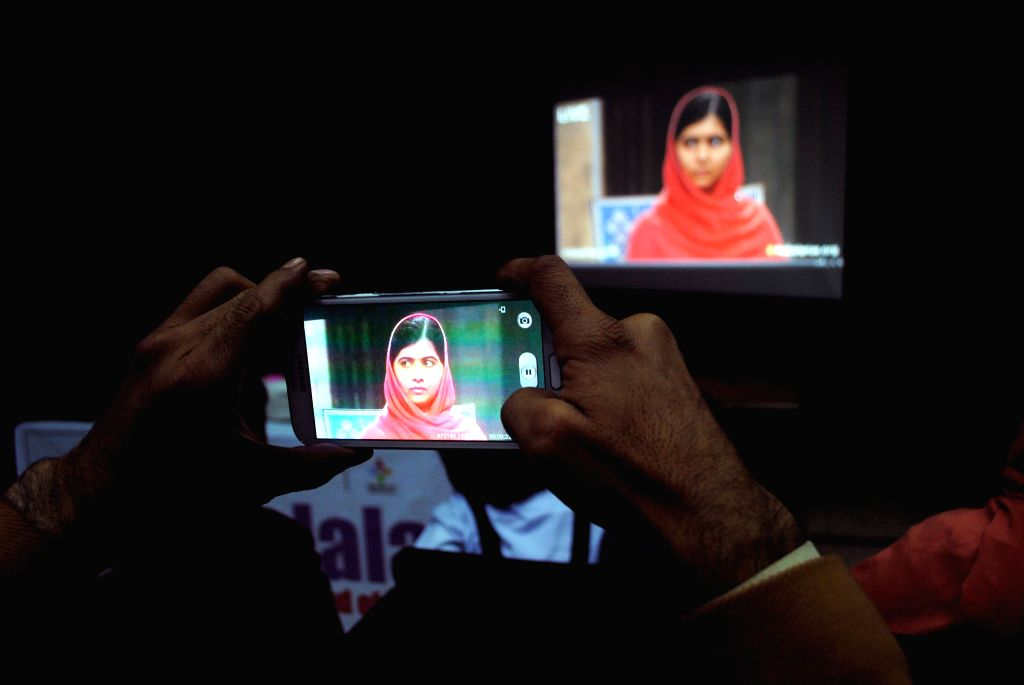 A Pakistani man watches a live broadcast of the award ceremony of joint Nobel Peace Prize laureate in Peshawar, Pakistan, Dec. 10, 2014. Kailash Satyarthi and Malala Yousafzai, two child ... - Kailash Satyarthi
