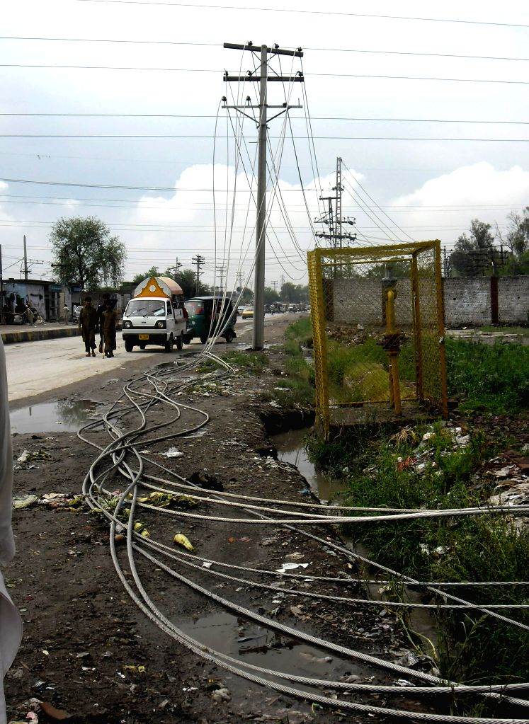 Electricity wires are fallen after heavy rain in northwest Pakistan's Peshawar, April 30, 2015.