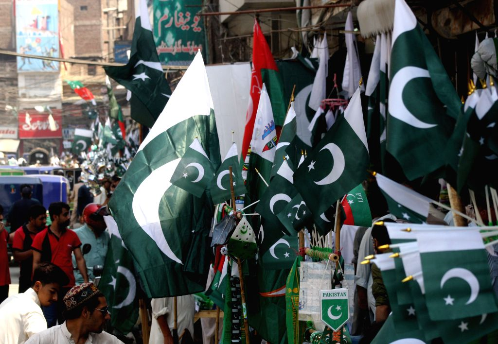 PESHAWAR, Aug. 13, 2016 - Pakistani people buy national flags on the eve of the country's Independence Day in northwest Pakistan's Peshawar on Aug. 13, 2016. Pakistan will celebrate its 69th ...