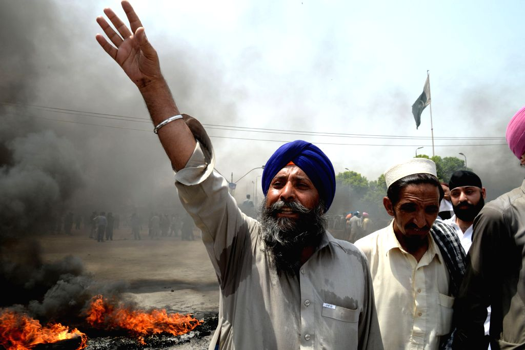 A Pakistani minority Sikh shouts slogans during a protest against the killing of a colleague in northwest Pakistan's Peshawar on Aug. 6, 2014. A Sikh trader was ...
