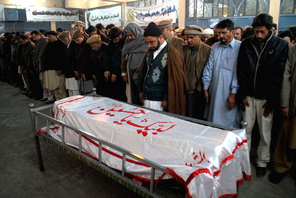Mourners attend the funeral of a student who was killed in an attack by militants on an army-run school in northwest Pakistan's Peshawar on Dec. 16, 2014. A total .