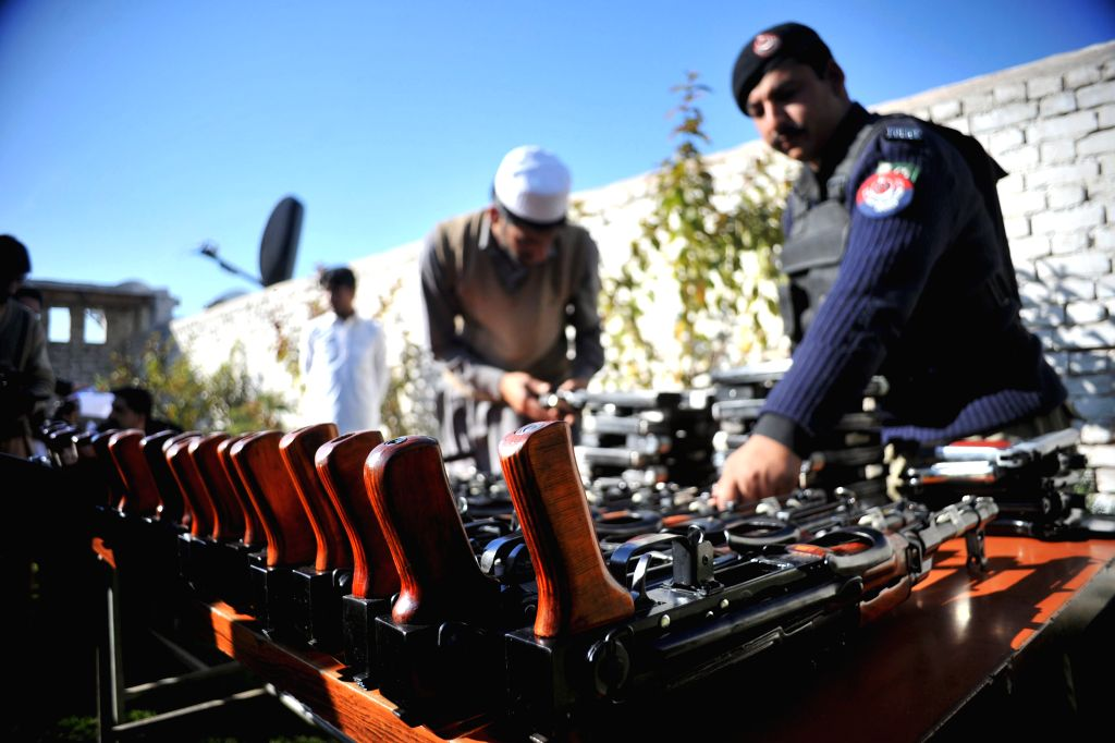 PESHAWAR, Feb. 26, 2017 - A policeman displays seized weapons to media in Peshawar, Pakistan on Feb. 26, 2017. Pakistani security forces recovered huge amount of weapons and ammunition from Peshawar ...