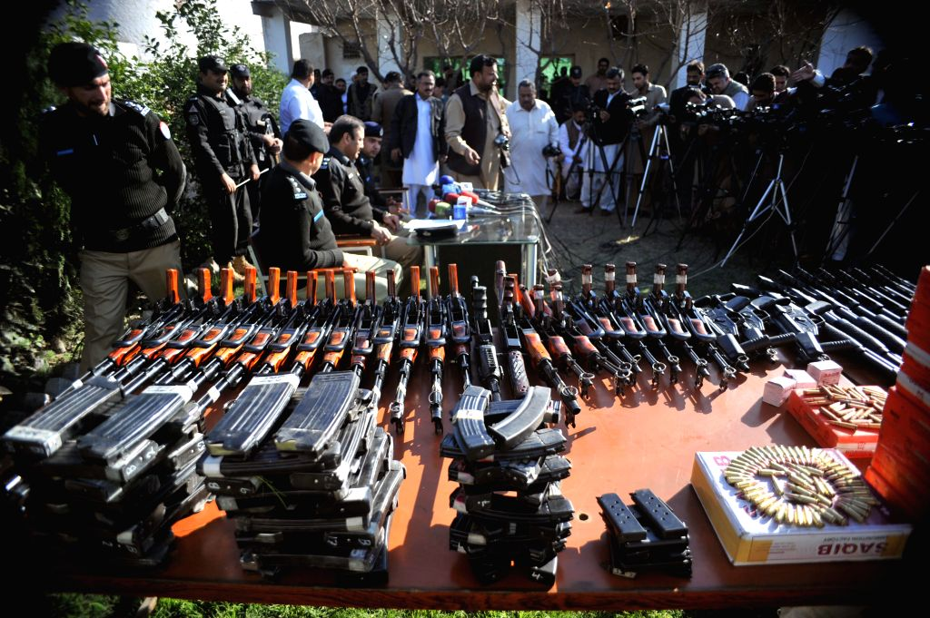 PESHAWAR, Feb. 26, 2017 - Policemen display seized weapons to media in Peshawar, Pakistan on Feb. 26, 2017. Pakistani security forces recovered huge amount of weapons and ammunition from Peshawar ...