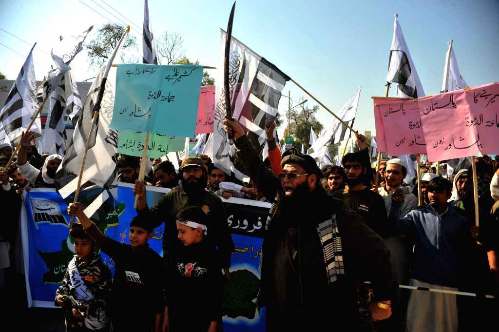 """Demonstrators shout slogans during the Kashmir """"Solidarity Day"""" rally in northwest Pakistan's Peshawar, Feb. 5, 2015. Pakistan observed Kashmir Solidarity"""