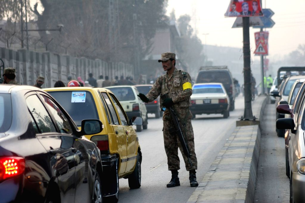 A Pakistani soldier stops vehicles near the Army Public School in northwest Pakistan's Peshawar, Jan. 12, 2015. Schools in Pakistan's northwestern city of Peshawar