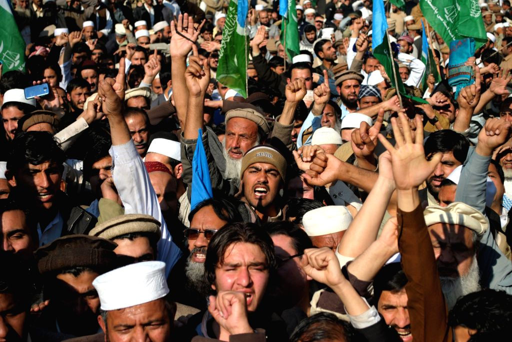Pakistani people shout slogans against the printing of satirical sketches of the Prophet Muhammad by French magazine Charlie Hebdo during a protest in northwest ...