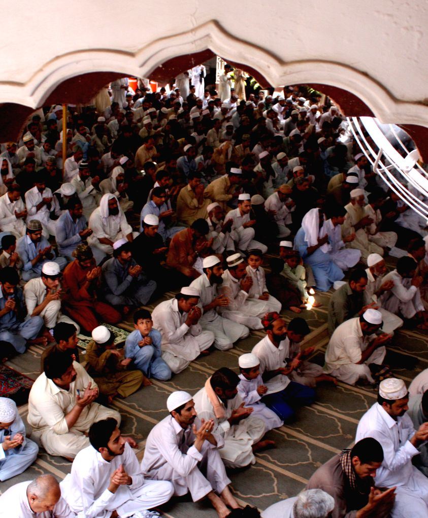 PESHAWAR, July 1, 2016 - Pakistani Muslims offer Jummat-ul-Vida, the last congregational Friday prayers in the holy month of Ramadan, at a mosque in northwest Pakistan's Peshawar, July 1, 2016. ...