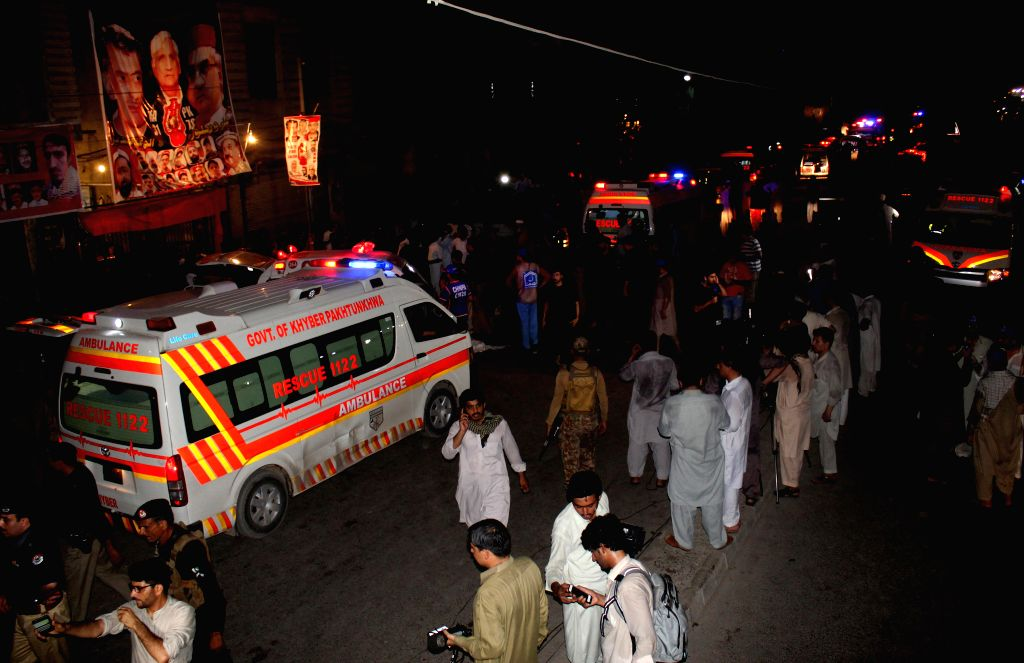 PESHAWAR, July 10, 2018 - An ambulance is seen near the blast site in Peshawar, northwest Pakistan, on July 10, 2018. At least 13 people were killed and dozens of others injured in a blast that hit a ...