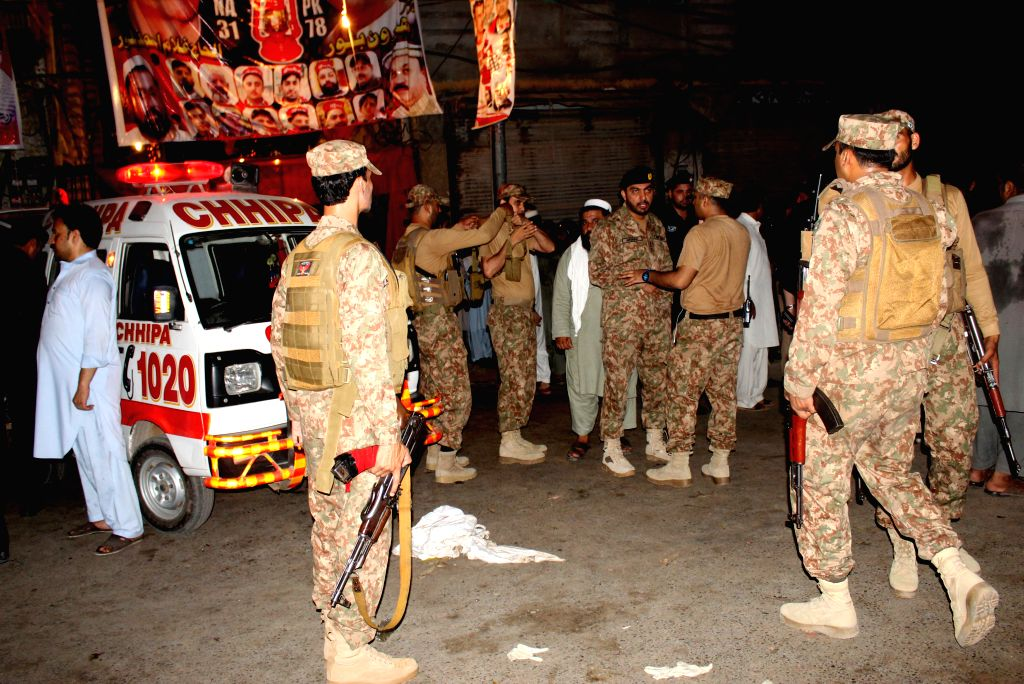 PESHAWAR, July 10, 2018 - Pakistani army arrive at the blast site in Peshawar, northwest Pakistan, on July 10, 2018. At least 13 people were killed and dozens of others injured in a blast that hit a ...