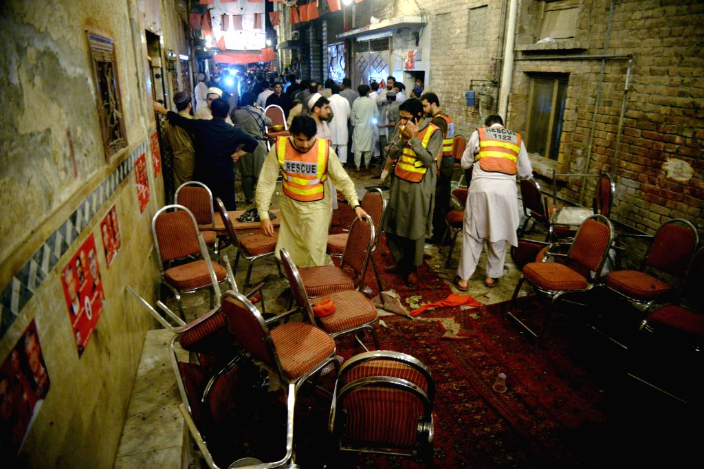 PESHAWAR, July 10, 2018 - Rescuers work at the blast site in Peshawar, northwest Pakistan, on July 10, 2018. At least 13 people were killed and dozens of others injured in a blast that hit a public ...