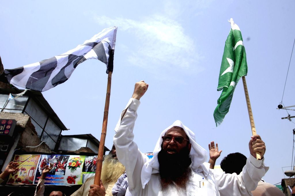 PESHAWAR, July 15, 2016 - A Pakistani activist shouts slogans during a protest against recent deaths of Kashmiri protesters during clashes with Indian security forces in Indian controlled Kashmir, in ...