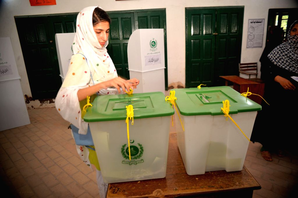 PESHAWAR, July 25, 2018 - A woman casts vote at a polling station in northwest Pakistan's Peshawar, on July 25, 2018. Pakistan held the general elections on Wednesday.