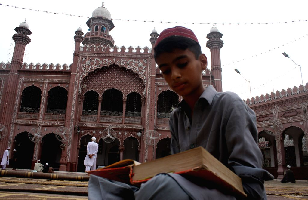 PESHAWAR, July 4, 2016 - A boy reads the holy Quran at a mosque during the Ramadan in northwest Pakistan's Peshawar on July 4, 2016.