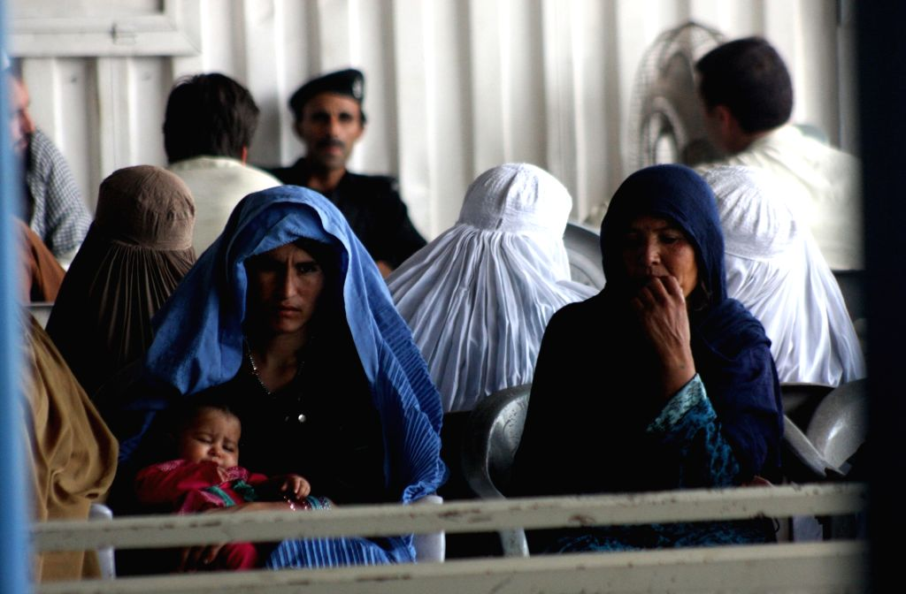 PESHAWAR, June 19, 2017 - Afghan refugees sit at the office of the United Nations High Commissioner for Refugees (UNHCR) registration center ahead of the World Refugee Day, in northwest Pakistan's ...