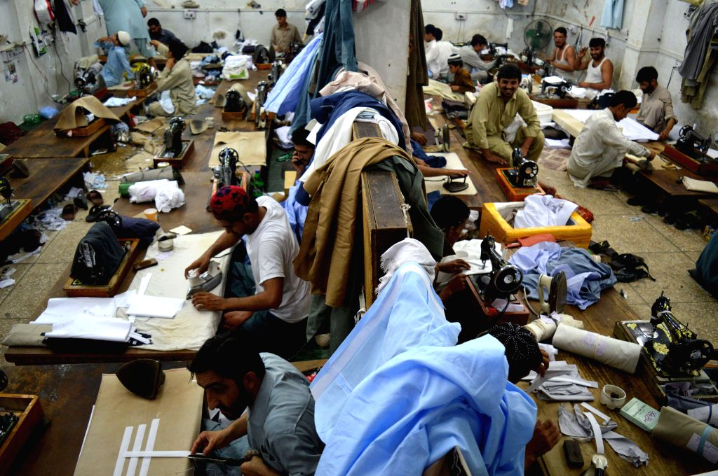 PESHAWAR, June 28, 2016 - Tailors stitch clothes for the upcoming Eid al-Fitr festival in northwest Pakistan's Peshawar, June 28, 2016. Muslims around the world prepare to celebrate the Eid al-Fitr ...