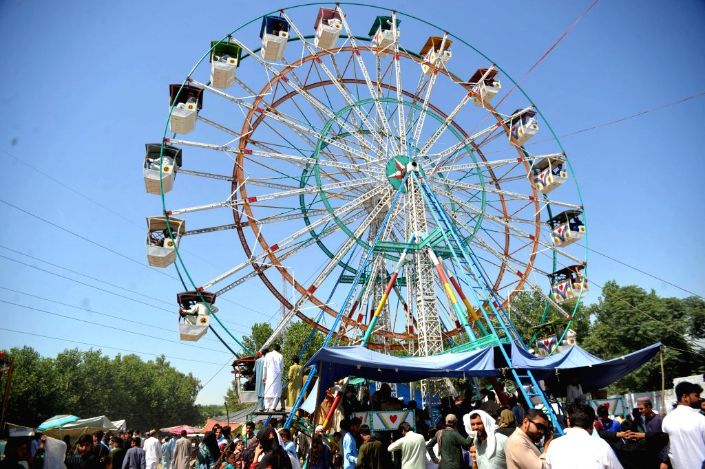 PESHAWAR, June 7, 2019 - People enjoy ride on a Ferris wheel during Eid al-Fitr holiday on the outskirts of northwest Pakistan's Peshawar on June 7, 2019.