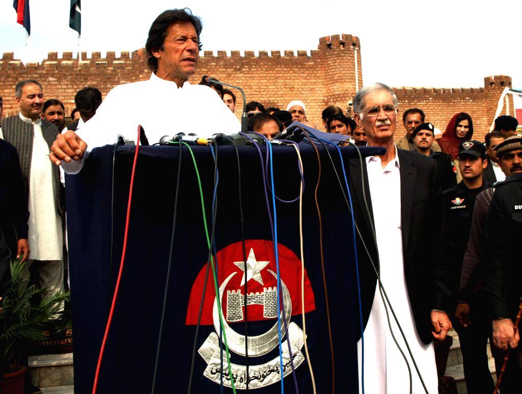 Pakistan Tehreek-e-Insaf (PTI) Party Chairman Imran Khan (front) addresses a press conference in northwest Pakistan's Peshawar, March 14, 2015. (Xinhua/Ahmad ...