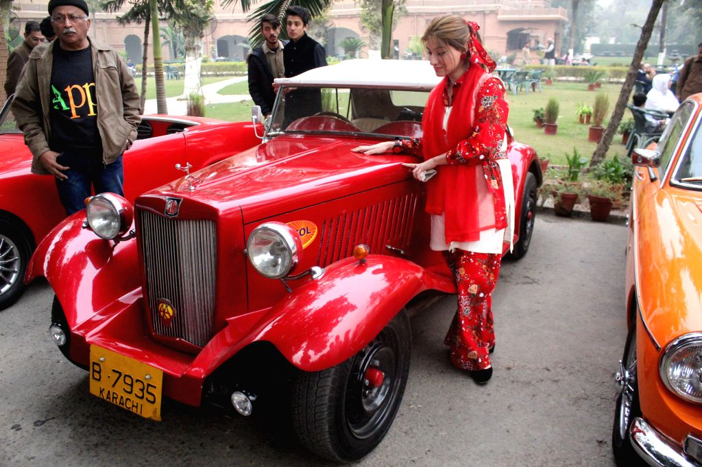 PESHAWAR, Nov. 20, 2016 - People visit the 7th Vintage Classic Car Rally in northwest Pakistan's Peshawar, Nov. 20, 2016. As many as 75 classic and other vehicles participated in the rally started on ...
