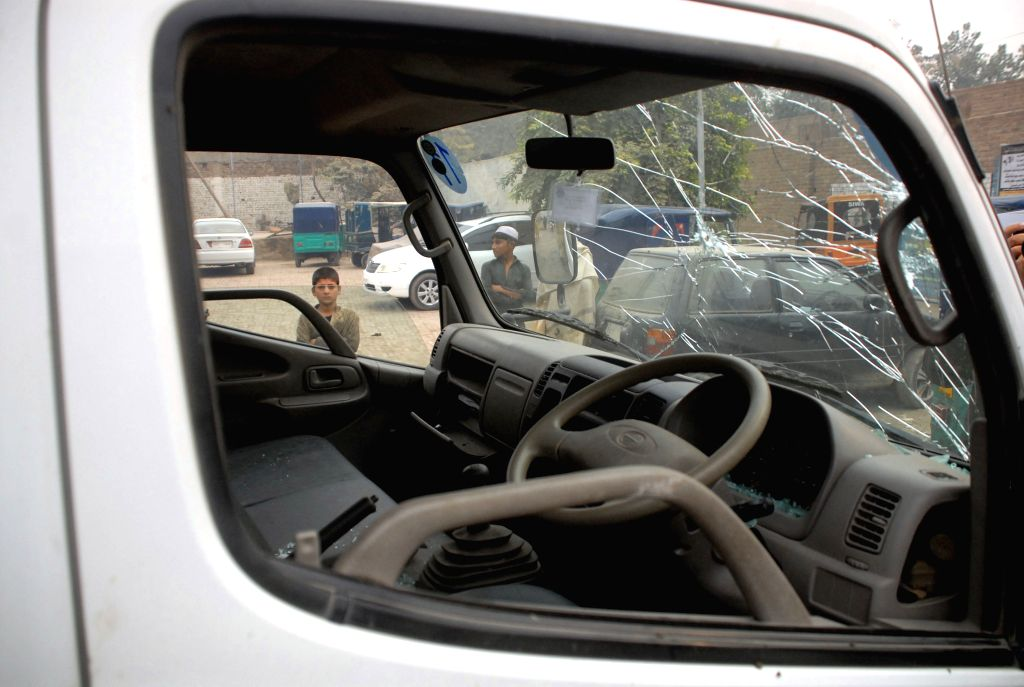 PESHAWAR, Nov. 22, 2016 - A damaged security personnel vehicle is seen at the blast site in northwest Pakistan's Peshawar on Nov. 22, 2016. At least three Frontier Constabulary (FC) personnel were ...
