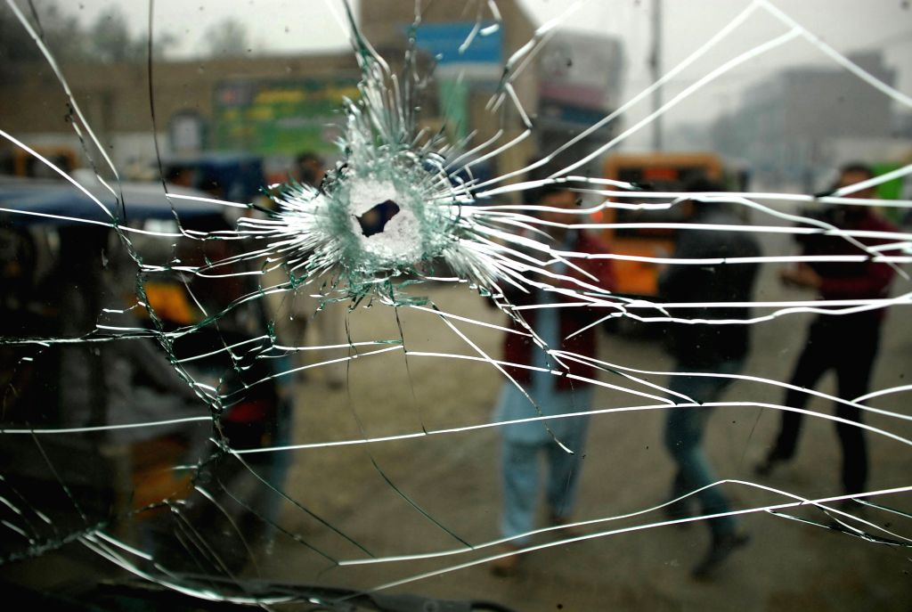 PESHAWAR, Nov. 22, 2016 - Locals gather near a security personnel vehicle at the blast site in northwest Pakistan's Peshawar on Nov. 22, 2016. At least three Frontier Constabulary (FC) personnel were ...