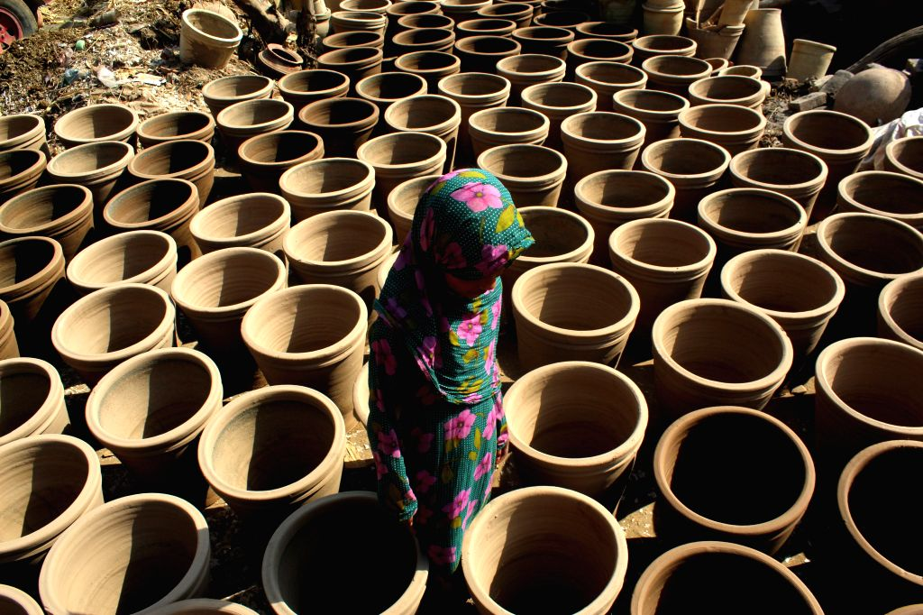 PESHAWAR, Oct. 14, 2016 - A girl arranges pottery at a workshop in northwest Pakistan's Peshawar, Oct. 14, 2016. Pottery is a very big part of Pakistani culture.