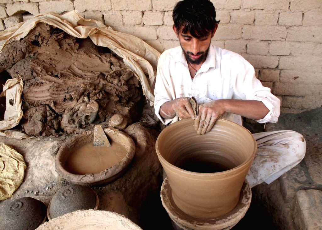PESHAWAR, Oct. 14, 2016 - A worker makes pottery at a workshop in northwest Pakistan's Peshawar, Oct. 14, 2016. Pottery is a very big part of Pakistani culture.